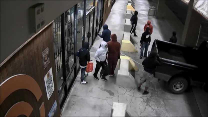 A very detailed surveillance video shows a group of robbers breaking into a gun store in Houston, Texas.