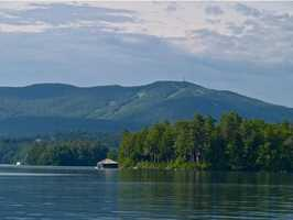 With spectacular lakefront views and an iconic boathouse, this landmark Lake Sunapee home is one of a kind.