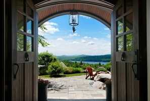 Open your front door in this New London home and be treated to amazing views of Pleasant Lake.