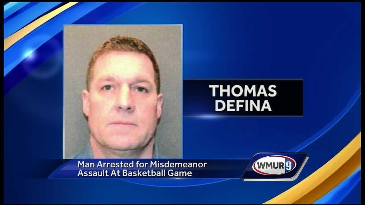 A misdemeanor assault charge was filed against a Manchester firefighter Wednesday after an incident at a high school basketball game in Wolfeboro.