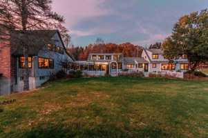 We're featuring something a little different for today's Mansion Monday -- a family compound called Thistle Dew Farm, which features an apple orchard, greenhouse, exterior barn and more than 1,000 feet of shoreline. The home is featured on realtor.com.