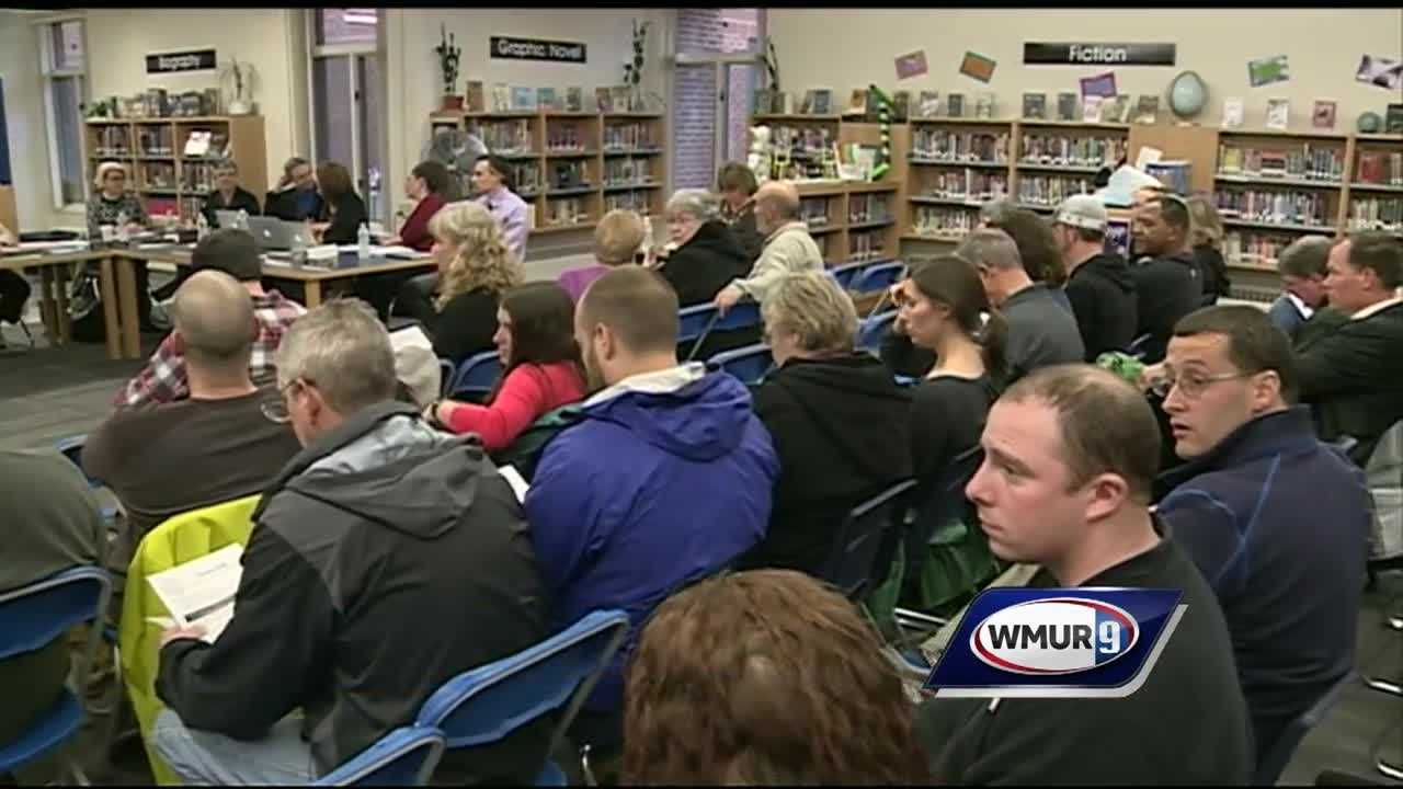 Dozens of parents gathered at Henry W. Moore school in Candia Thursday night to discuss a proposed policy for transgender students.