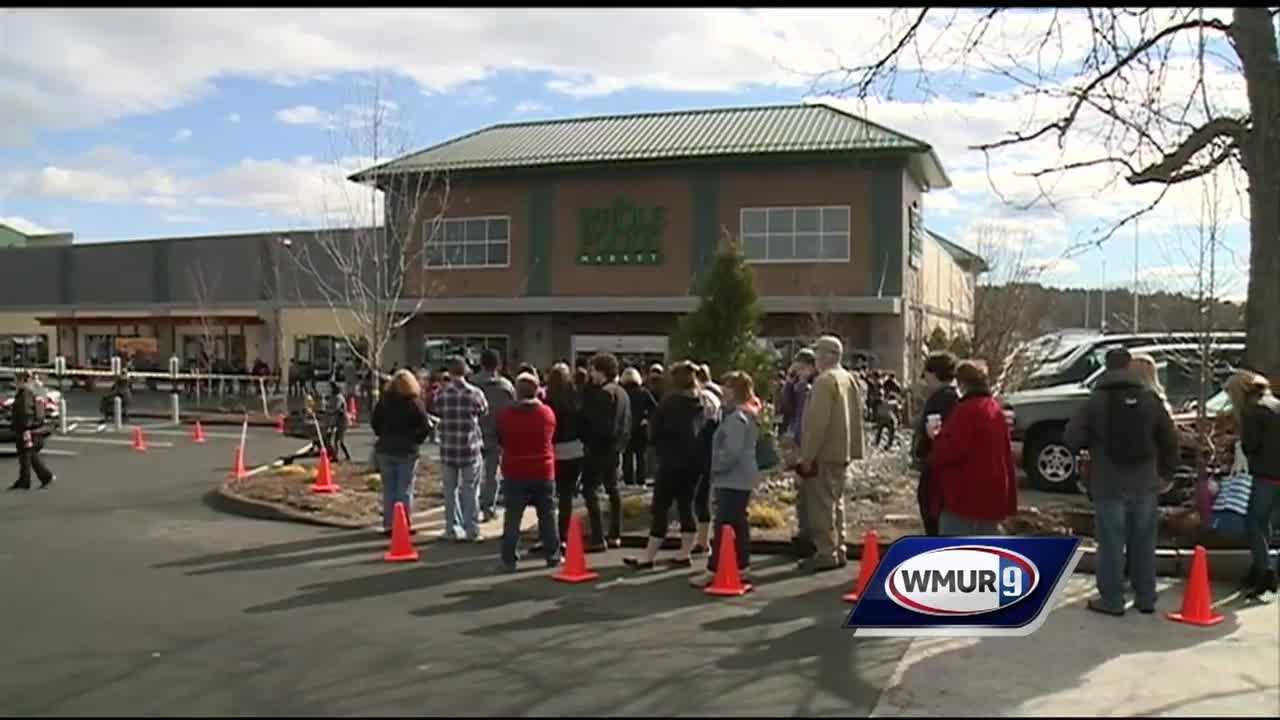 Big crowds greeted Friday's grand opening of a new Whole Foods Market in Bedford.
