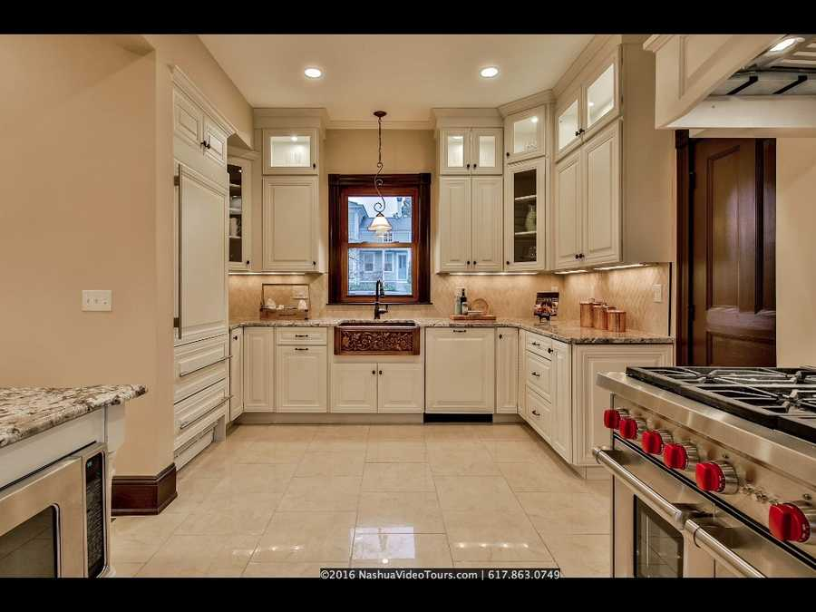 A modernized kitchen provides a great deal of space.