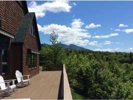 The custom contemporary offers a panoramic view of the White Mountain National Forest.