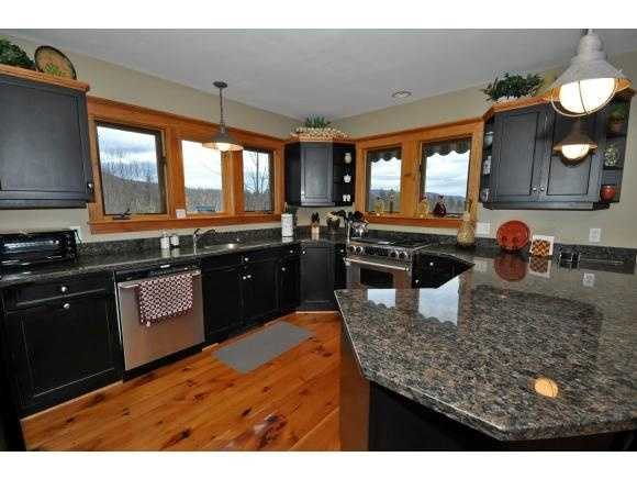 The gourmet-style kitchen has stainless appliances and granite counters.