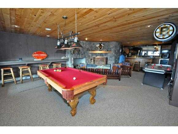 The finished game room features a pool table, among other fun options.