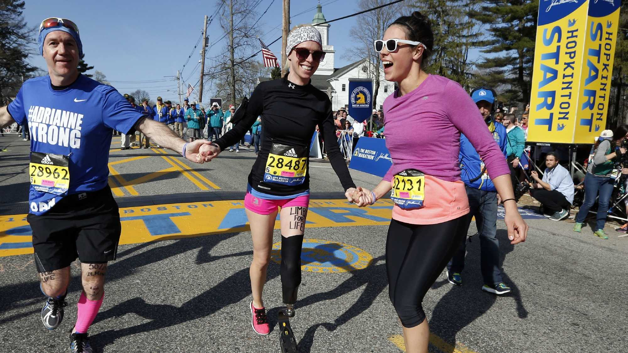 Boston Marathon bombing survivor Adrianne Haslet, center, starts the 120th Boston Marathon.
