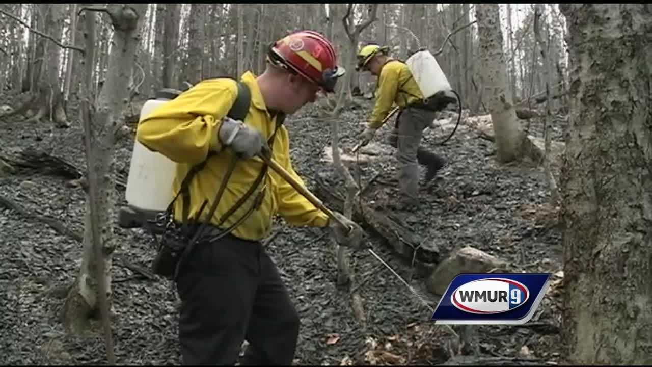 Firefighters spent a second day Monday trying to put out a brush fire in Brookfield as the fire danger remained high across the state.