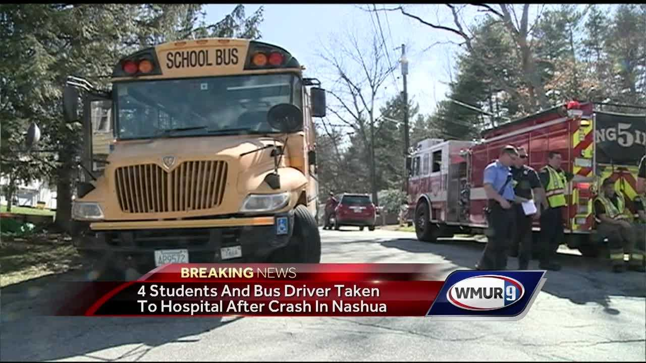 Four students were taken to a hospital as a precaution after a school bus and a car collided Thursday afternoon in Nashua.