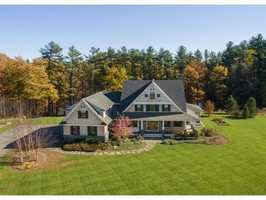 The home enjoys commanding water and pastoral views.