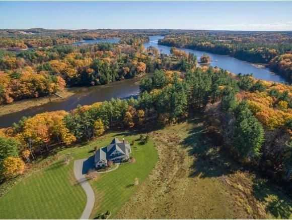 The home is surrounded by tidal waters and is enclosed by a scenic treeline.