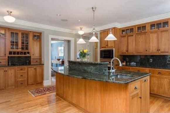 The kitchen has custom-built Jewett Farms cabinetry and Sub-Zero and Wolf appliances.