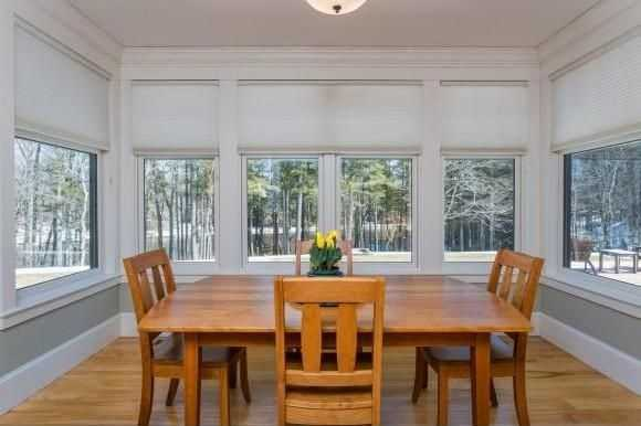 The dining area offers a panoramic view of the property.