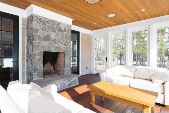 The living areas have back-to-back wood-burning fireplaces handcrafted by master masons.