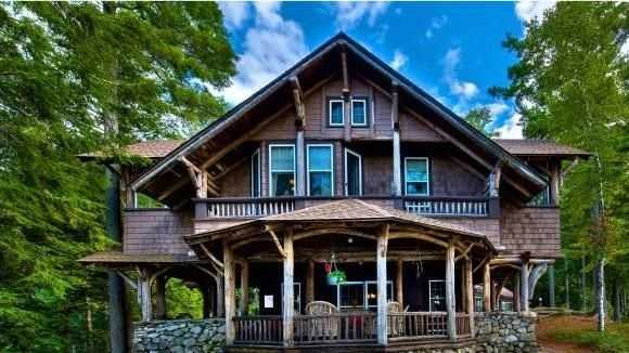 Mansion monday adirondack style home has water views for Adirondack style homes