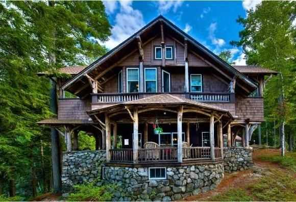 The Adirondack-style home features customized exterior and interior woodwork.