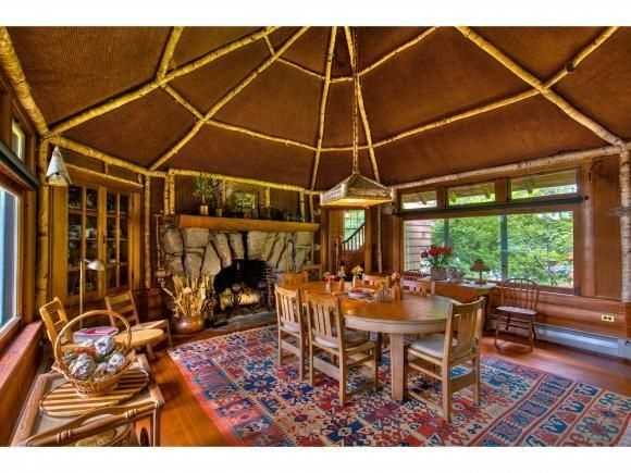 This unique dining area has a massive wood stove.