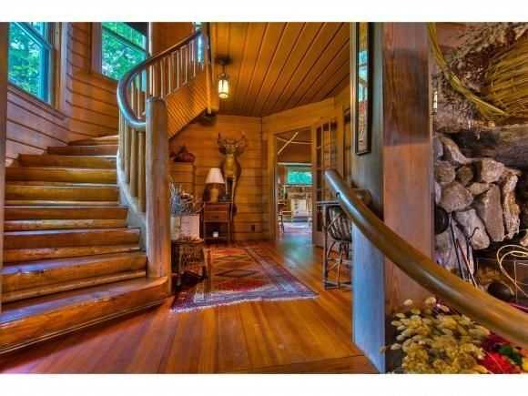 A winding stair case connects to the home's second level.
