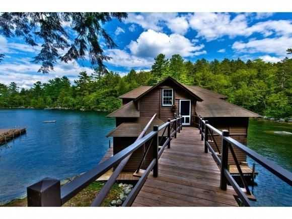 The boathouse is set in a protected cove overlooking a private grotto.
