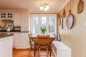 A small nook is built into the kitchen for alternate dining needs.