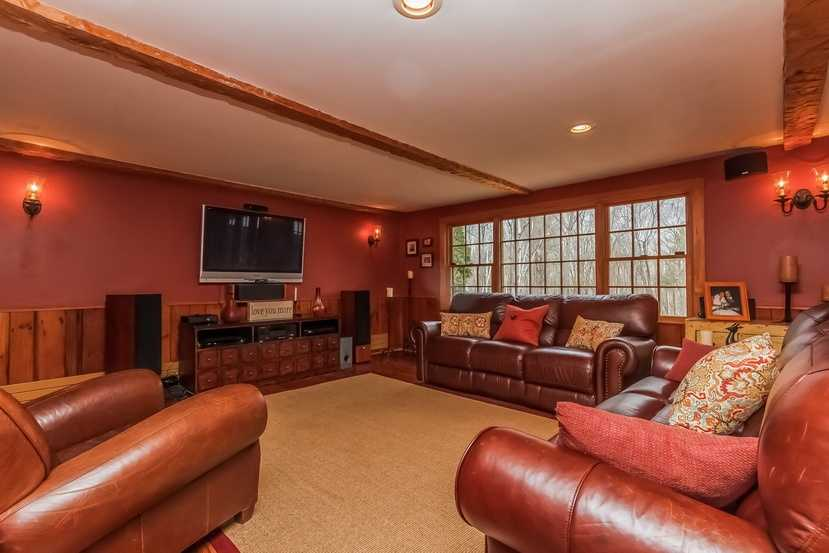 A generous amount space in the family room allows for watching the big game in comfort.