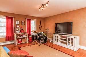 A smaller den-style room creates more entertainment options.