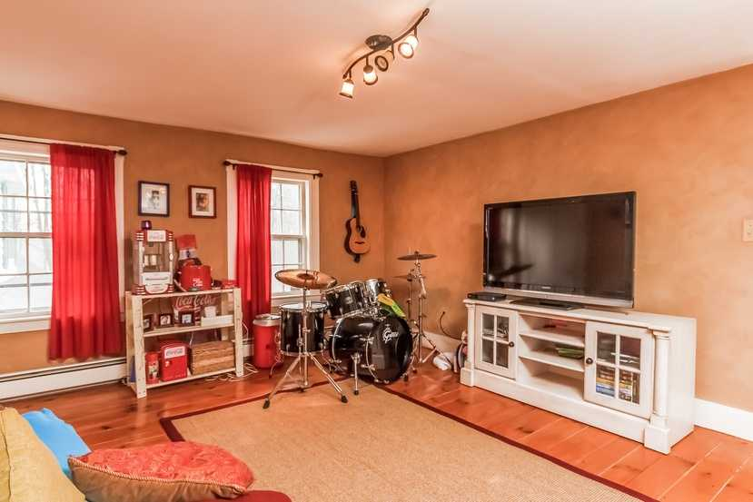 A smaller den-style room creates more entertainment options.