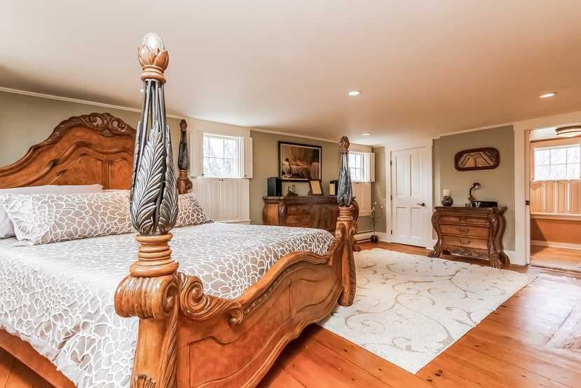 The master bedroom has gorgeous wood floors, a romantic fireplace, cedar closet, and a walk-in closet.
