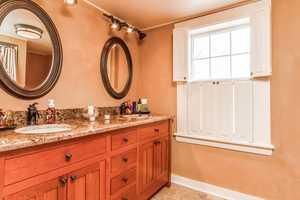 The master bathroom has a custom tiled shower and heated tile floor.