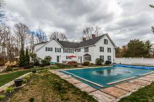 The home has a gorgeous in-ground pool overlooking idyllic gardens.