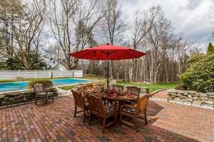 A second patio overlooks the 18x36 pool.