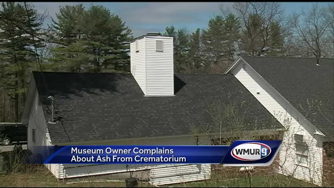 A business owner in Meredith said Friday he's thinking of relocating because of a crematorium next door.