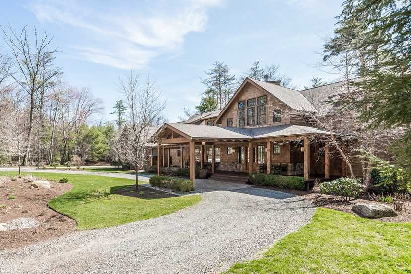 The luxurious Adirondack-style home at 31 Wallace Point Road in Moultonborough is on the market for $4,350,000.