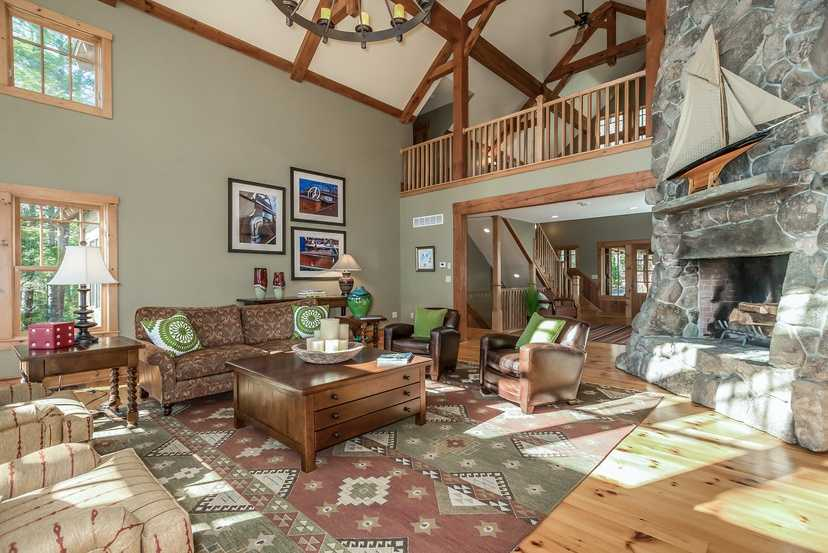 The home has a spacious great room with a large fireplace.