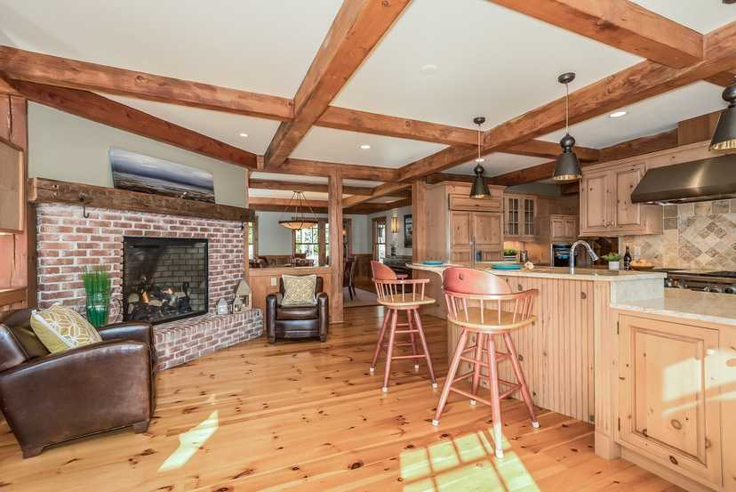 The home has a chef's kitchen with a walk-in pantry, bar-style seating and a fireplace.