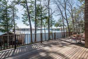 An expansive deck provides a beautiful view of the lake.
