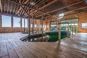 The home has a boathouse that accommodates two 36-foot boats.