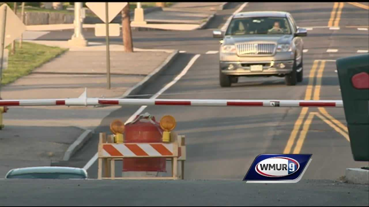 The city of Manchester is paying $25,000 to move a gate, just weeks after it was installed to divert traffic to and from the new Walmart on South Willow Street.