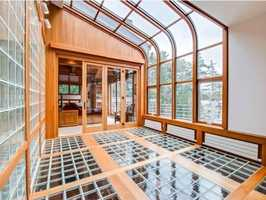 The home is decked out with glass walls, glass ceilings and glass floors.