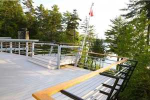 A private deck overlooks the property.