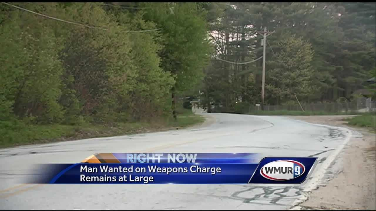 Police search for man wanted on weapons charge