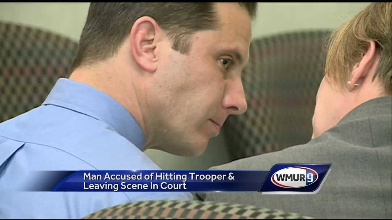 A man accused of hitting a New Hampshire state trooper on the side of the Everett Turnpike early Sunday morning turned himself in Wednesday.