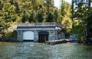 A stone boathouse comes equipped with multiple docks.