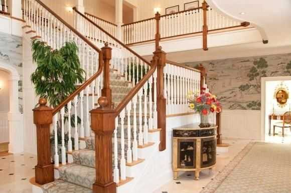A look at the home's elegant staircase and its wooden trim.