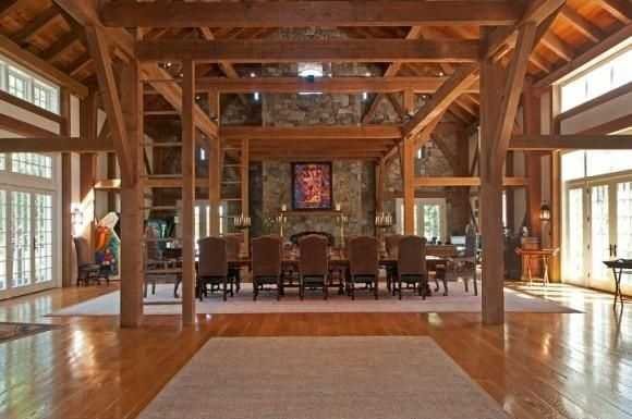 The entertainment barn is made up of wooden posts and beams.