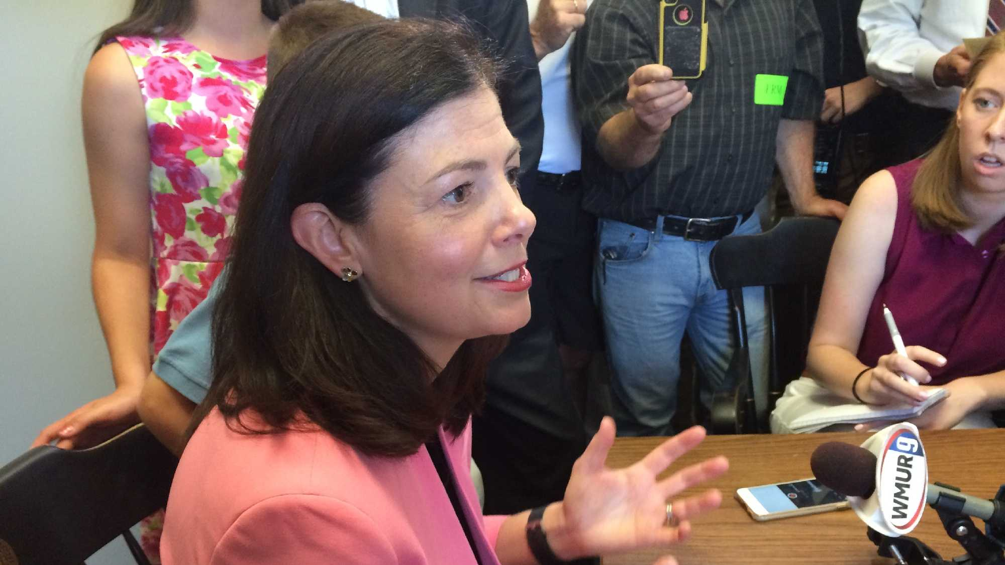 Sen. Kelly Ayotte speaks with reporters after filing her candidacy for re-election Wednesday at the State House.