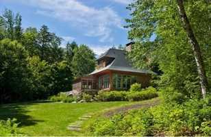 The timber-frame family compound is modeled after the Great Adirondack camps.