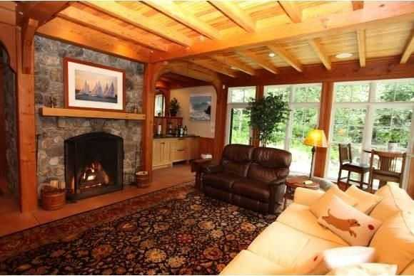 The home's living area has a beautiful stone fireplace.