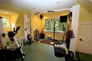 One of the home's room houses an array of fitness equipment.